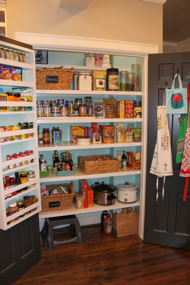 A fairly wide closet pantry, but not a walk-in. Notice how the there is a place for everything but nothing is too specialized or custom. Allows for good flexibility.