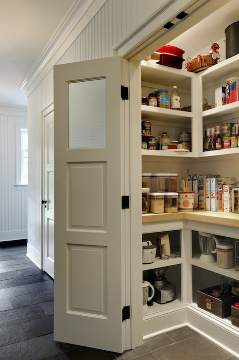 This is a beautiful pantry but the solid door and frosted glass mean that you wouldn't have to worry about how things looked on the inside if you didn't want to.