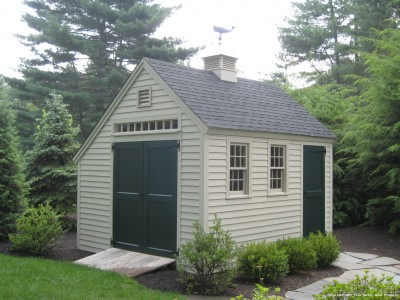 Would you believe this fantastically designed shed is a kit? Looks wonderful. Can't vouch for the product but in case you want to look into it, it is from Pine Harbor Wood Products.