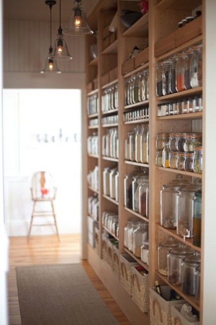 I think equally problematic is this open pantry. It is beautiful for sure, but perhaps only for someone who wants to transfer every food item to a glass jar. Not sure it is very practical, but visually interesting for sure.