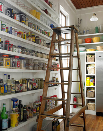 Not quite sure how this space relates to the kitchen and it looks good but the ladder is cumbersome and having things that high is not very practical. On the other hand the narrow shelves allow one to see everything without  having to move anything.